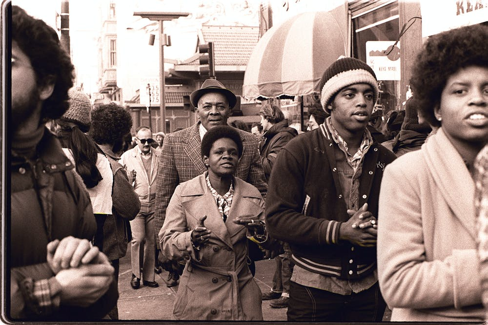 Members of Peoples Temple join the picket line in an anti-eviction protest at San Francisco's International Hotel in January 1977. Photo credit: Peoples Temple/Jonestown Gallery/Courtesy Nancy Wong
