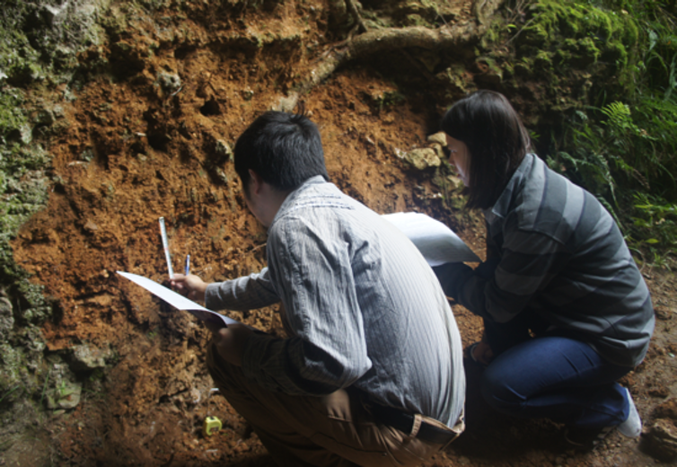 Bo Li and Hu Yue collecting sediment samples from the same layers the stone tools had been in, in order to redate them. Photo credit: Weiwen Huang, CC BY-ND