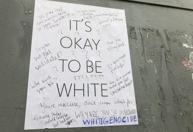 It's okay to be white poster photographed on the University of Toronto campus. Tom Yun/The Varsity