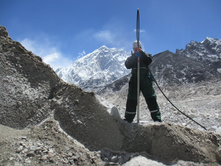 Researcher drilling into Khumbu, one of the Nepalese glaciers