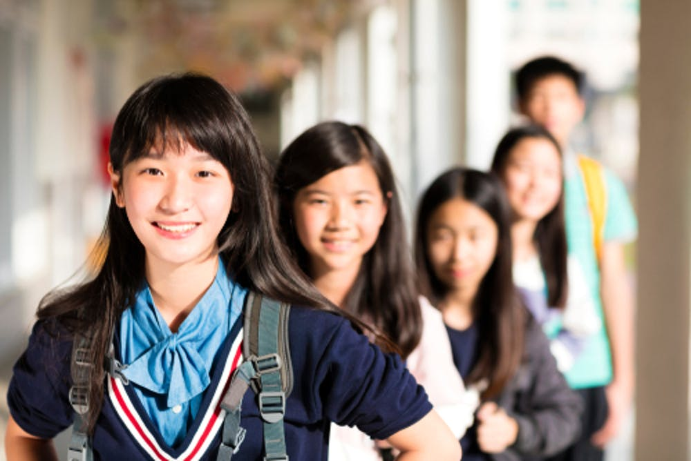 Many Asian-American students are socialized from an early age to score high  on college entrance exams.