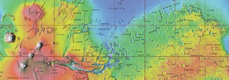 A topographic map of Mars thar has red in the middle before going into yellow and green regions.
