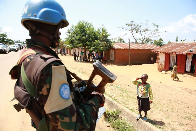 A Congolese child saluting a MONUSCO peacekeeper