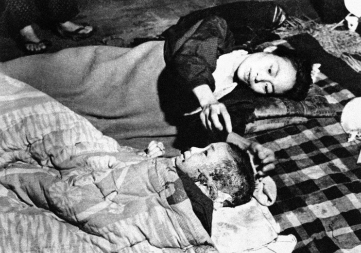 A mother and her child in the aftermath of the atomic bomb dropped on Hiroshima.