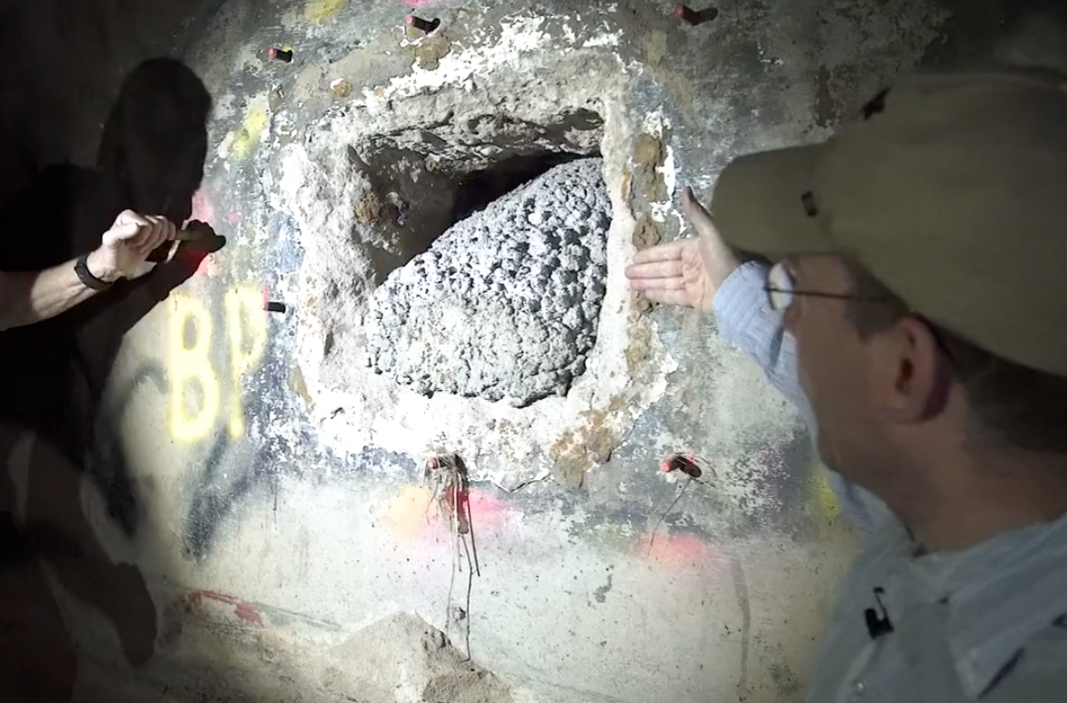 Freelancer Ioan Grillo points to a hole in a drainage tunnel underneath the city of Nogales, at the US-Mexico border. Drug traffickers often cut through the tunnel wall to get into the United States. Photo credit: Matt Cipollone, CC BY