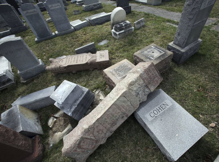 Toppled headstones at Mount Carmel Cemetery in Philadelphia Feb. 27, 2017.  A report on the vandalism cited an increase in anti-Semitic bias since the 2016 election. Jaqueline Larma/AP Photo