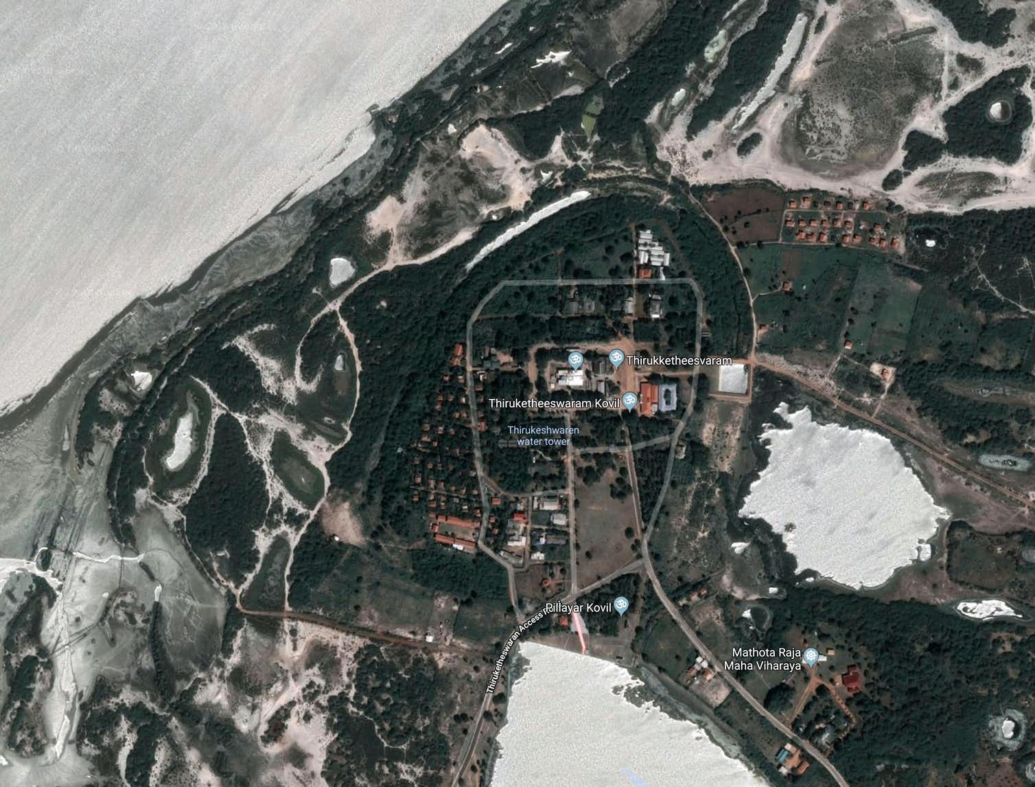 Mantai as seen from the air today. The ancient circle of ditches built to defend the site can be seen in dark green. The main settlement was inside these defences. Credit: Google Maps