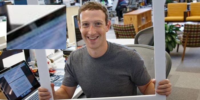 Facebook CEO Mark Zuckerberg covers the webcam of his computer