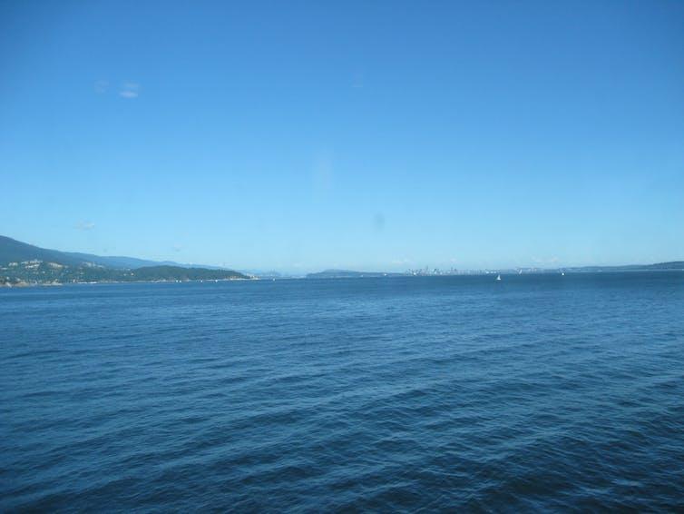 A blue ocean and blue sky