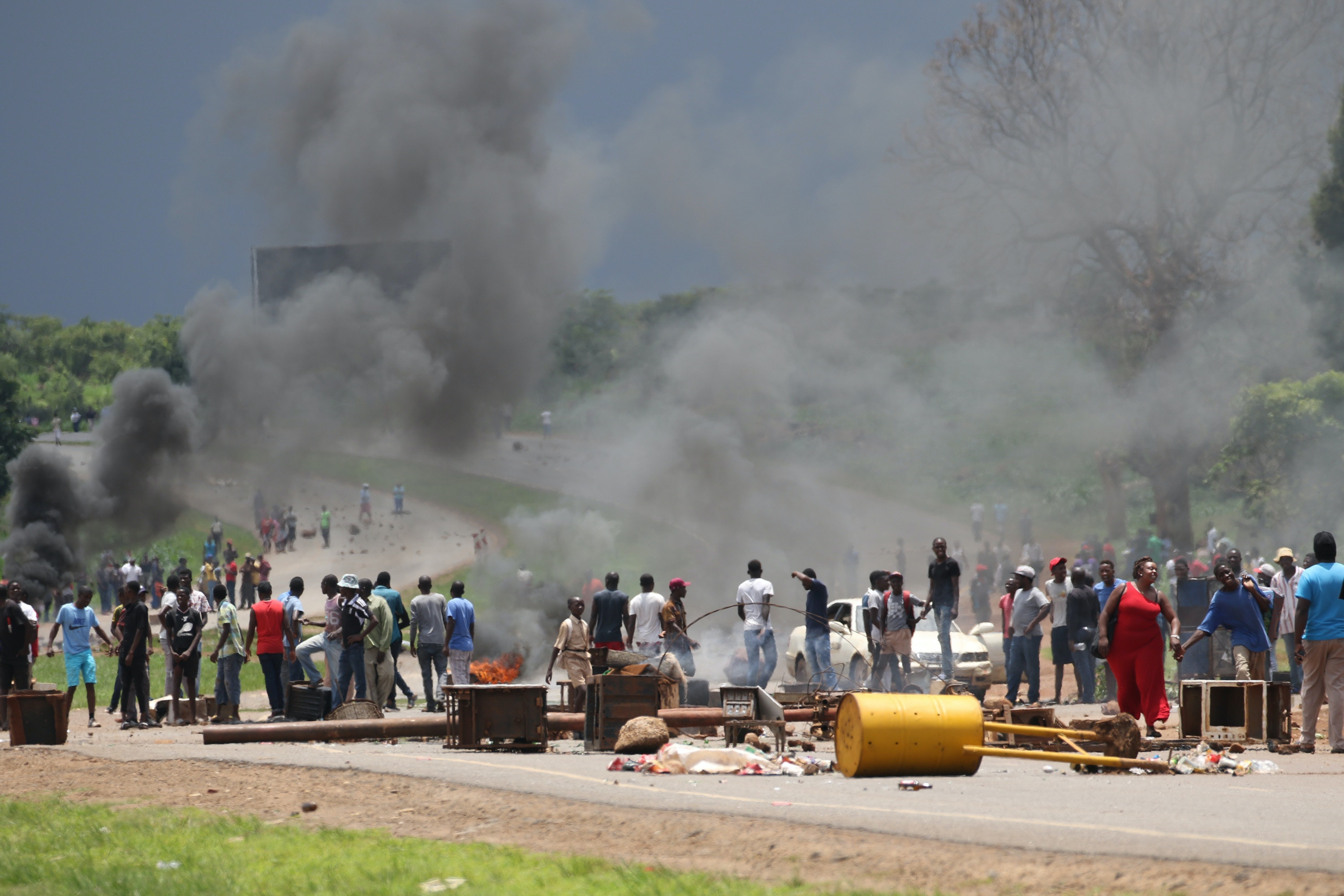 What needs to be done to stop Zimbabwe's violent meltdown