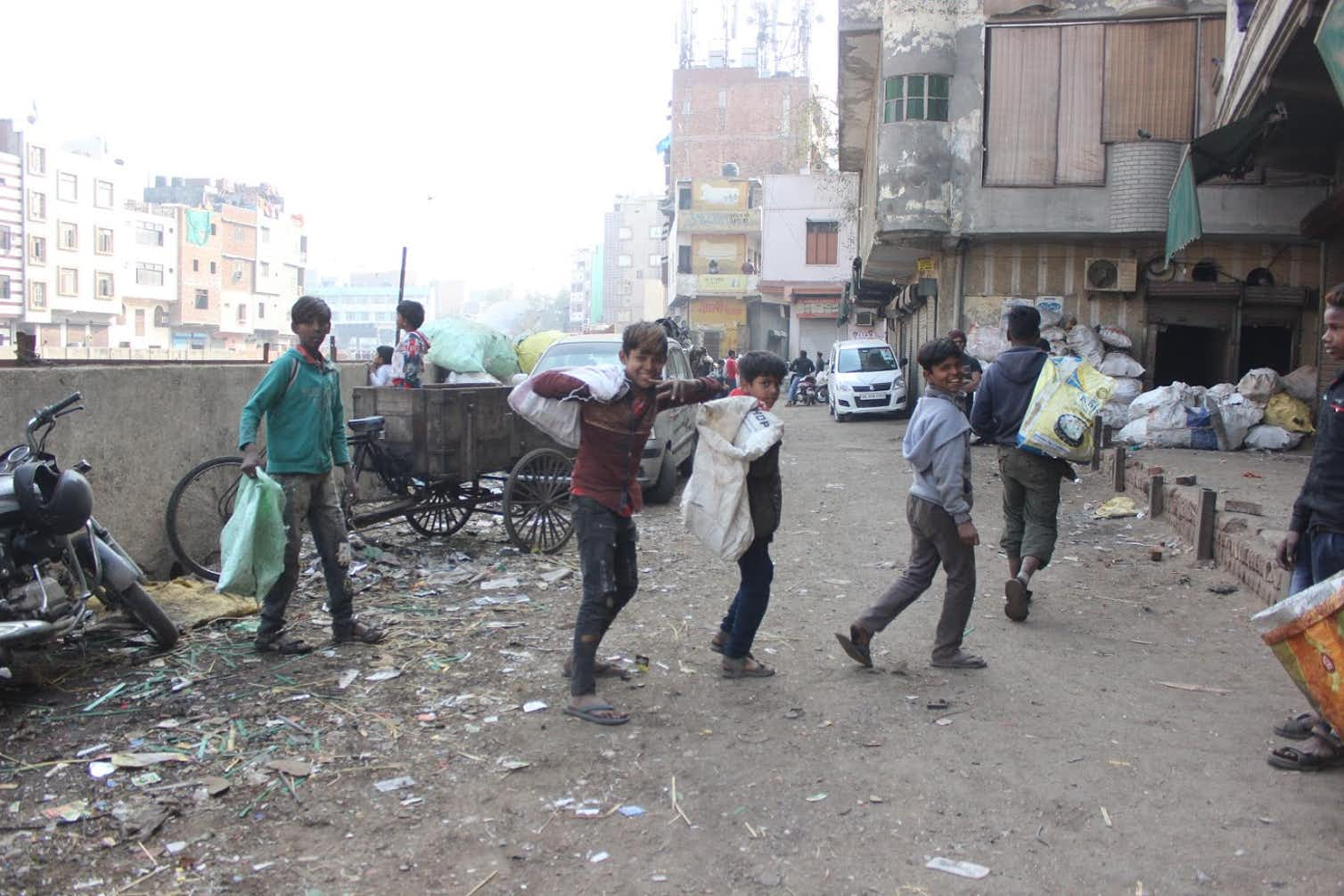 Young boys searching for valuable metal components they can sell in Seelampur. Photo credit: Author provided