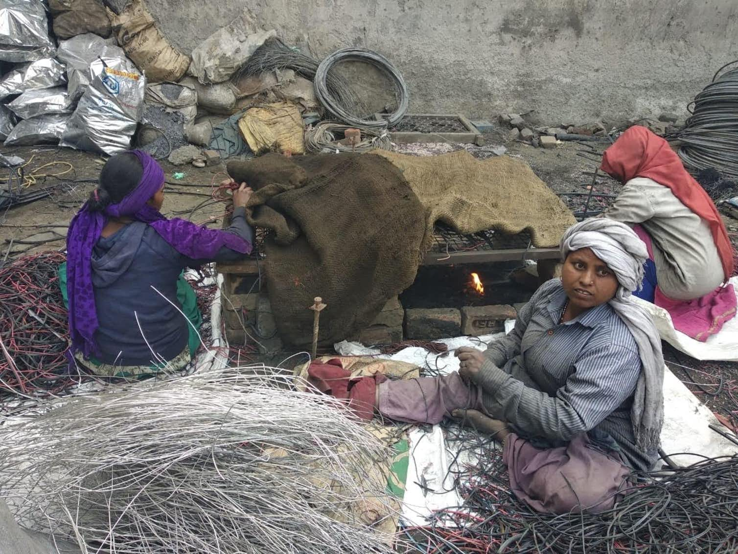 Women extracting copper from electrical wires, in a highly polluting process. Photo credit: Alankrita Soni, Author provided