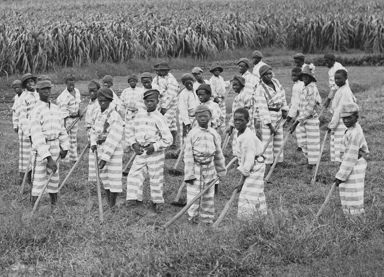 Southern jails made money leasing convicts for forced labor in the Jim Crow South. Circa 1903.