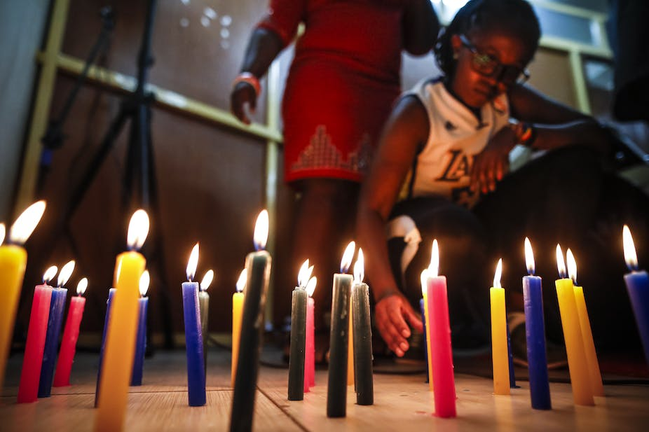 Churchgoers in Nairobi who support gay rights lit candles ahead of the  court ruling. EPA-EFE/Dai Kurokawa
