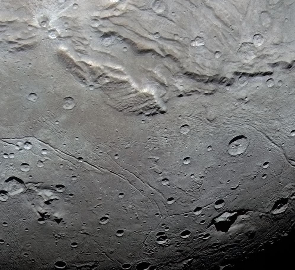 Detail of Charon's Vulcan Planitia, where small craters are deficient in numbers. Photo credit: NASA/Johns Hopkins University Applied Physics Laboratory/Southwest Research Institute