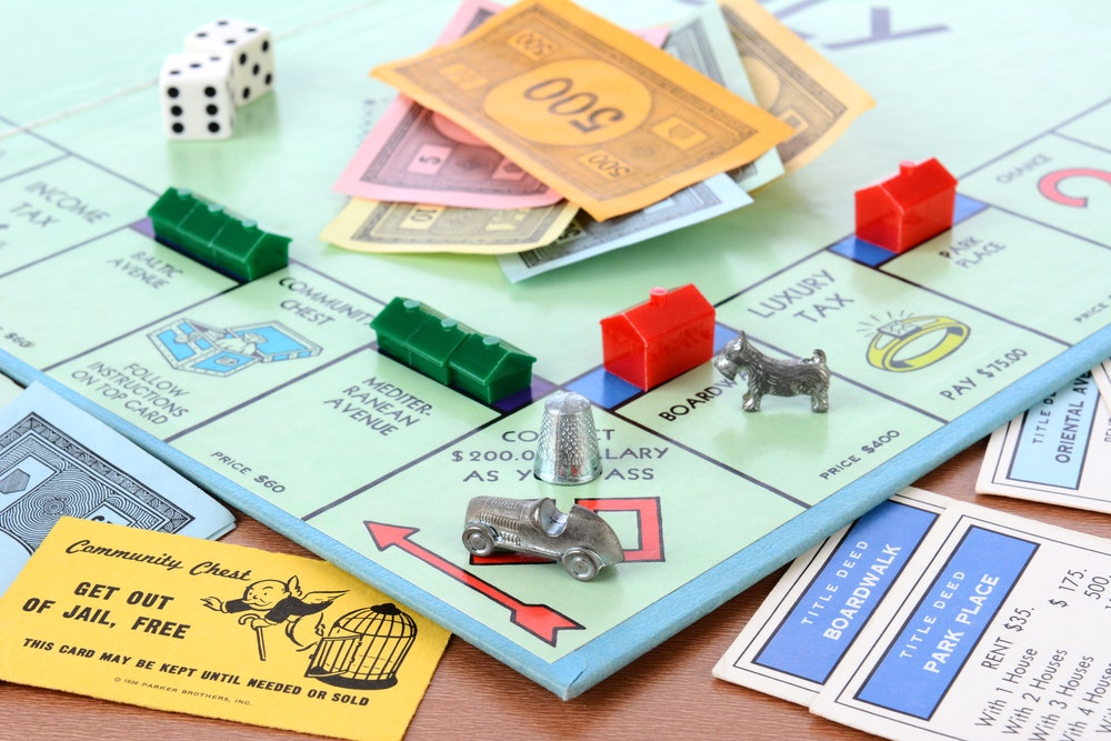 Monopoly was designed by a progressive writer to teach players the dangers of wealth concentration.