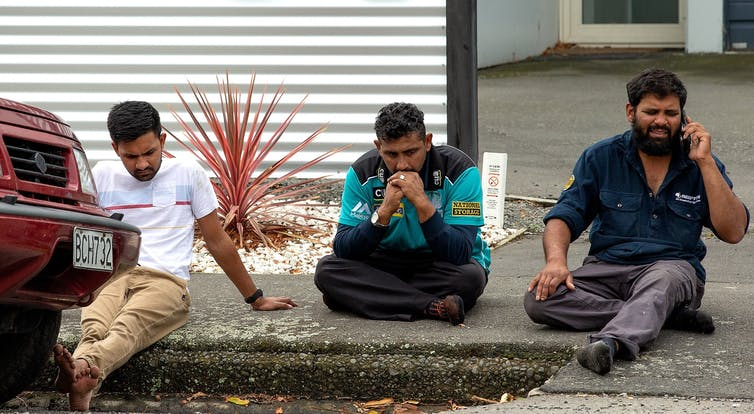 Grieving members of the public following a shooting at the Masjid Al Noor in Christchurch. EPA/Martin Hunter, CC BY-SA John Battersby, Massey University