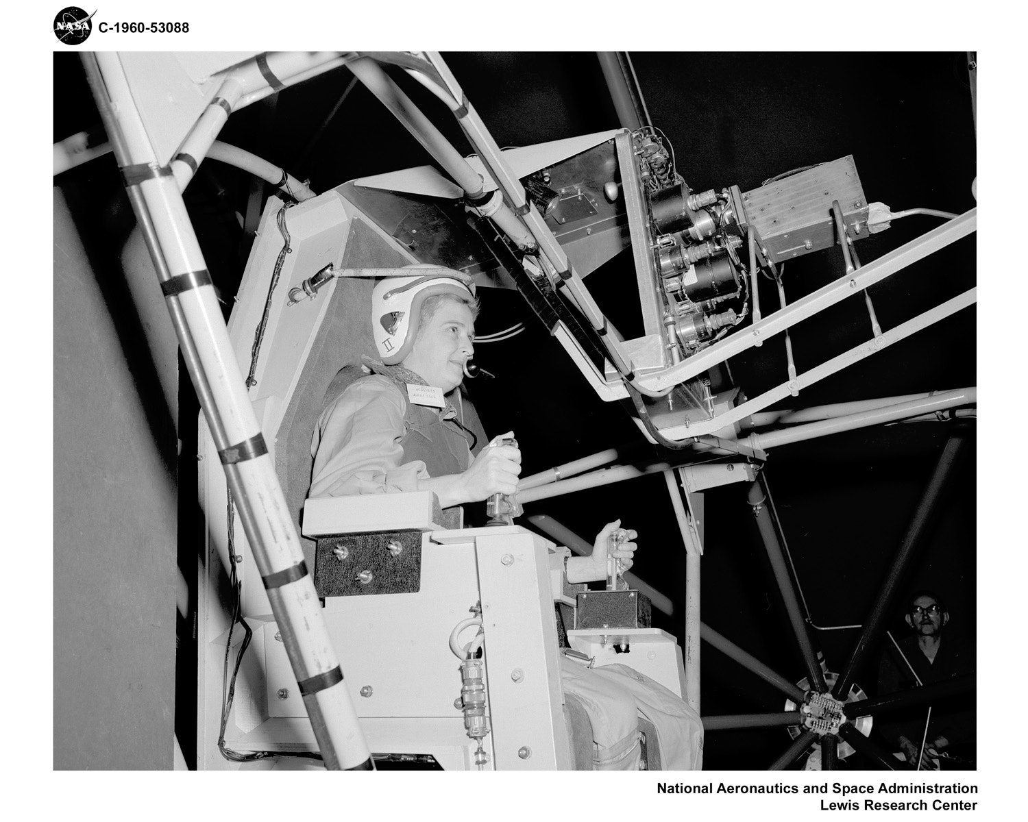 Jerrie Cobb, testing the Gimbal Rig in the Altitude Wind Tunnel in April 1960. The Gimbal Rig was used to train astronauts to control the spin of a tumbling spacecraft. Photo credit: NASA