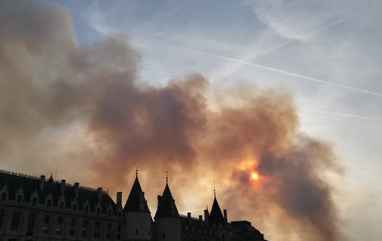 At about 7:20 p.m. on April 15, 2019, smoke from the burning cathedral obscured the sun. Jennifer Gallé, CC BY