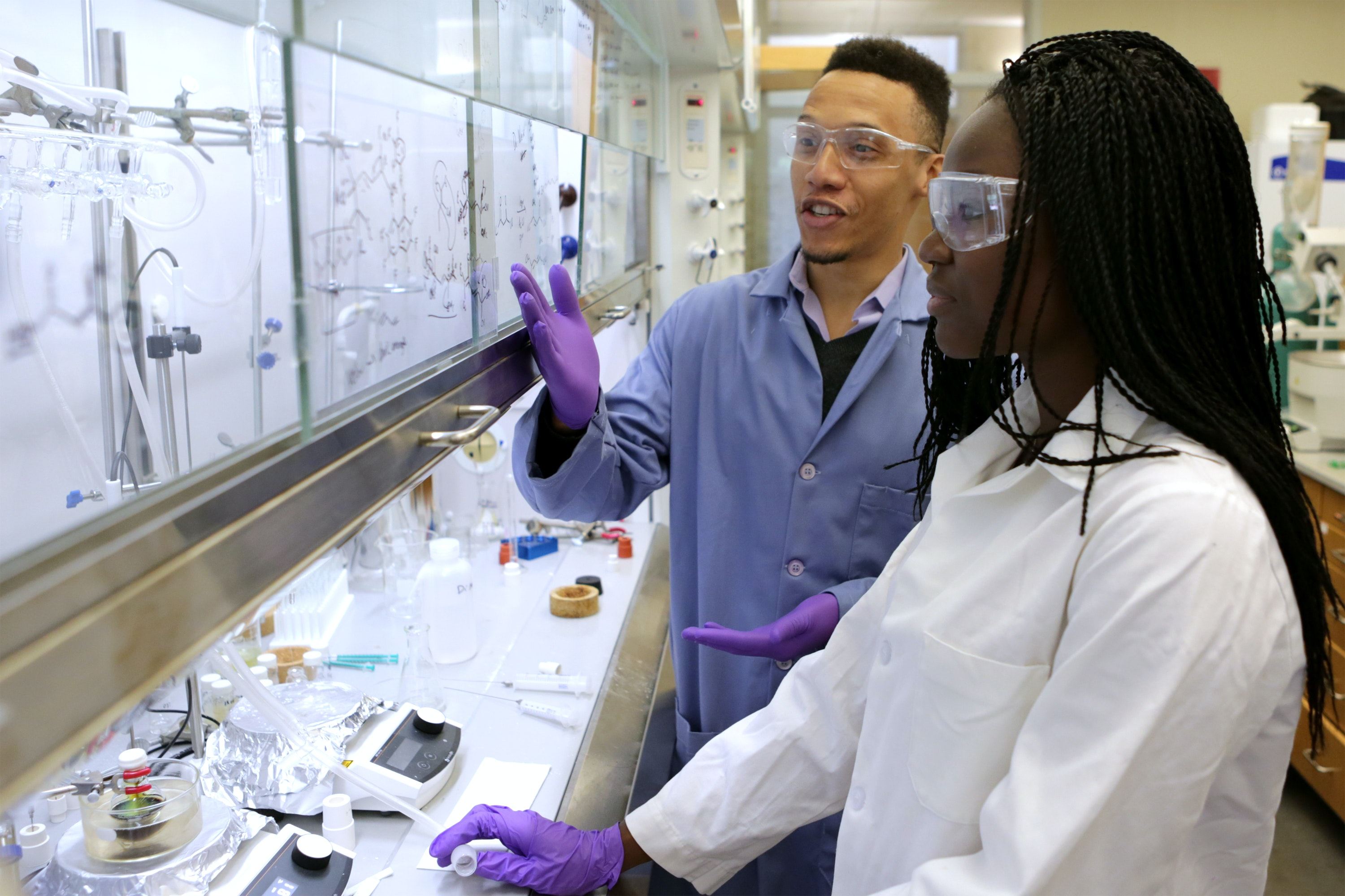 Assistant professor of chemistry Sidney Wilkerson-Hill, left, in a chemistry lab at the University of North Carolina at Chapel Hill, with Bolatito Babatunde, a student in the Chancellor's Science Scholars program at UNC. Lars Sahl / UNC Chemistry, CC BY