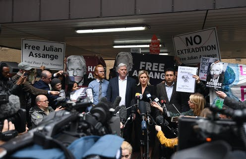 Julian Assange has refused to surrender himself for