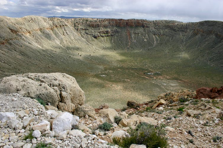 This meteor crater in Arizona was created 50,000 years ago when an iron meteorite struck the Earth. It is about one mile across. W. Herbst, CC BY-SA