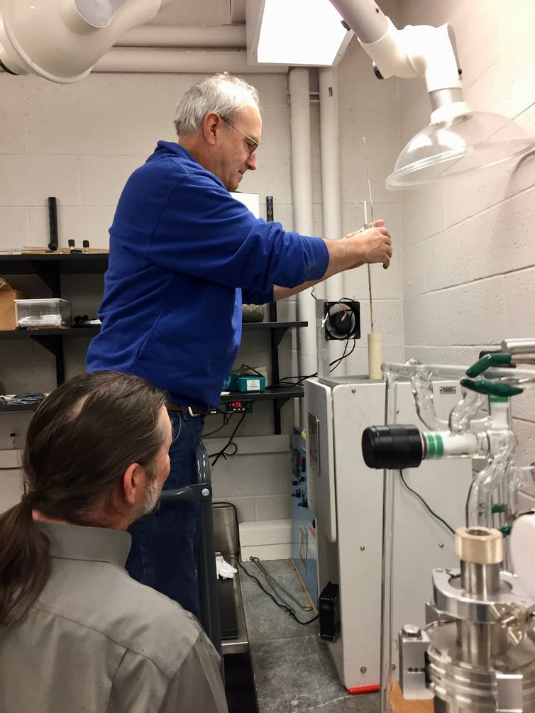 Laboratory technician Jim Zaresky (top) loads a programmable furnace as co-author Jim Greenwood looks on, in his laboratory at Wesleyan University. This is where the synthetic chondrules are made. W. Herbst