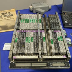 The Apollo Guidance Computer next to a laptop computer.