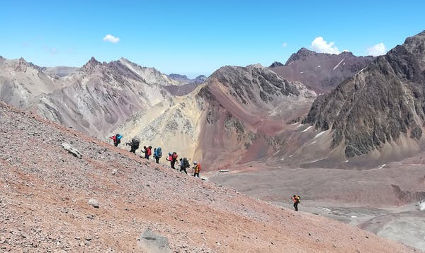 A commercial expedition heads up to Nido de Condores at 5,550m on Aconagua. Credit: Yana Wengel/The Conversation