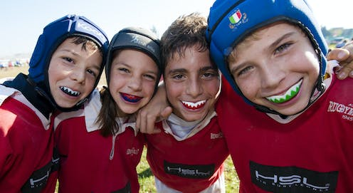 Children have fun playing sports and don't need to satisfy adults' ambitions