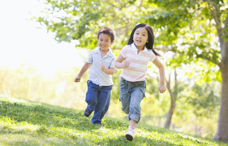happy-toddler-children-running-happily-outside-in-the-fresh-air-smiling