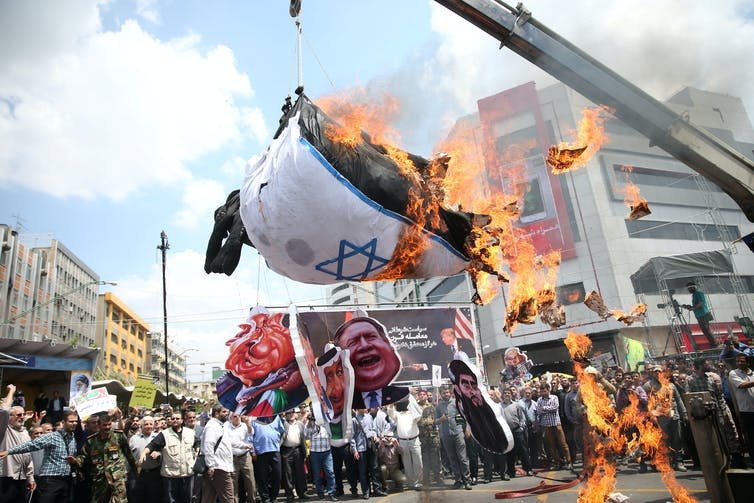 Iranians burn the flag of Israel at a march on Jerusalem Day on May 31. Credit: Tasnim News Agency/Reuters