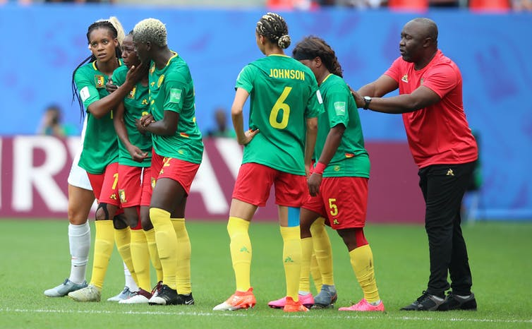 Cameroon players react with dismay after a goal is disallowed during their Women's World Cup clash with England, June 2019.