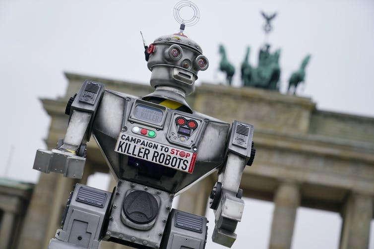 A 'robot' takes part in a campaign to ban Killer Robots, Berlin, March 2019. EPA-EFE/Alexander Becher