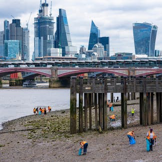 2ced6700fd4 London - June 19 2018: Volunteers cleaning the southern shores of the  Thames from waste during low tide. Daniel Lange/Shutterstock