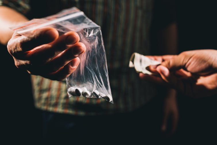 person buying illegal drugs
