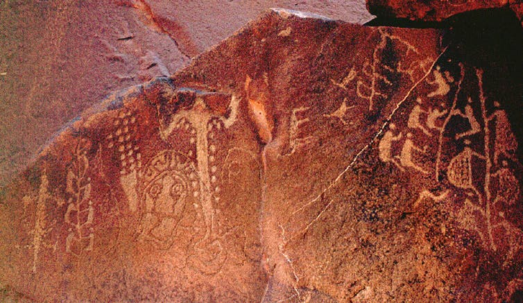 Drawings and carvings near the Burrup Peninsula in Western Australia