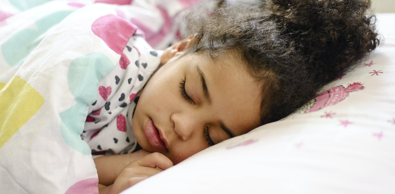 Curious Kids: why don't people fall out of bed when they are sleeping?