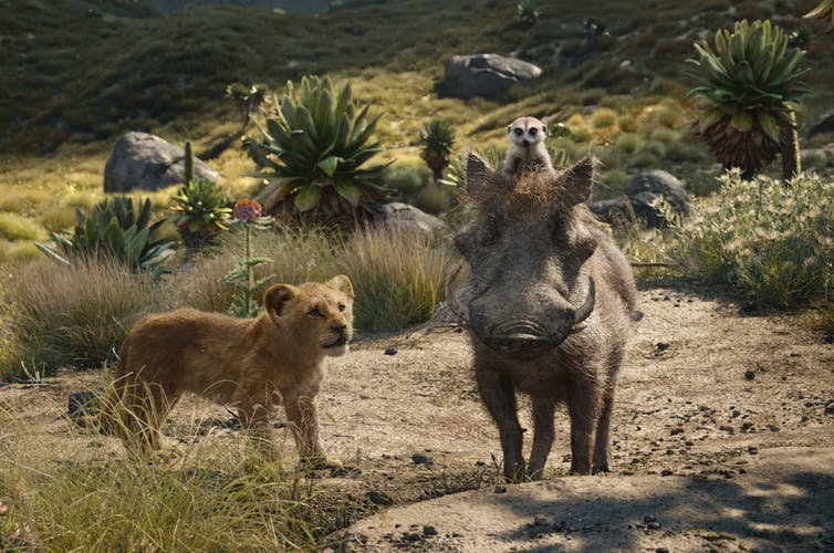 Pictured here, Simba, voiced by JD McCrary, Timon, a meerkat, voiced by Billy Eichner, and Pumbaa, a warthog, voiced by Seth Rogen, in a scene from 'The Lion King.' (Disney via AP, File)