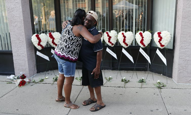Wreaths are laid for the victims of the Ohio attack. EPA/David Kohl
