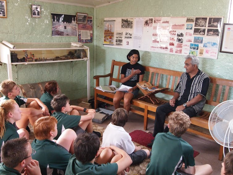 The author talks to local school children in the mosque in 201