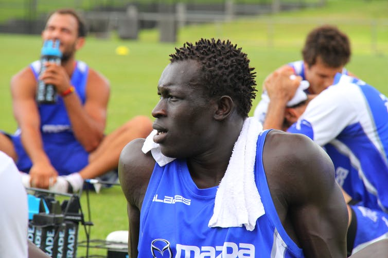 15b6581df34 Sudanese born North Melbourne player Majak Daw demonstrates the  multicultural appeal of Australian Rules. Credit  www.kangaroos.com.au