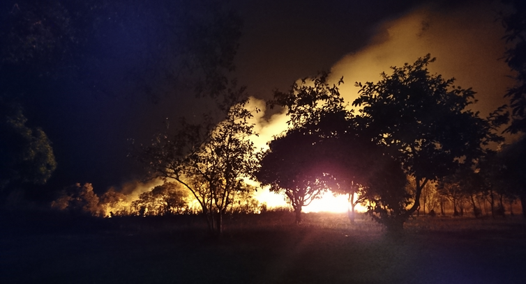 Human practices like burning the landscape – as in this night bush fire outside Kabwe, Zambia – have been affecting the Earth since long before the nuclear era.Andrea Kay, CC BY-SA