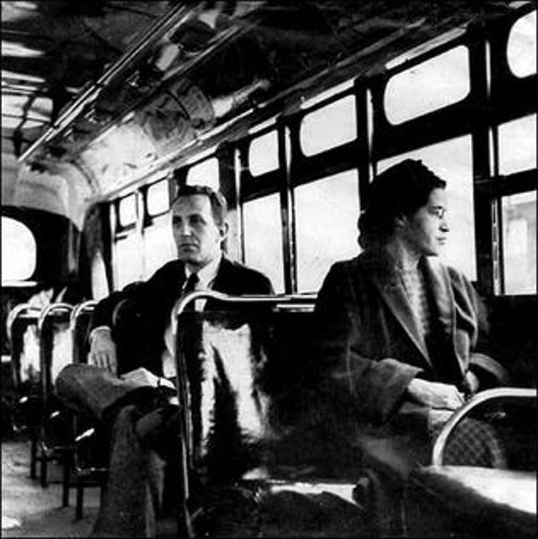 Rosa Parks sits in the front of a bus in Montgomery, Alabama, in 1956