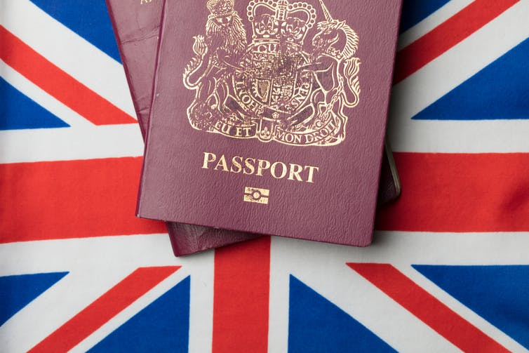 A British passport on a British flag