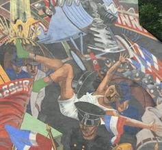 Detalle del mural de la Batalla de Cable Street, Londres.