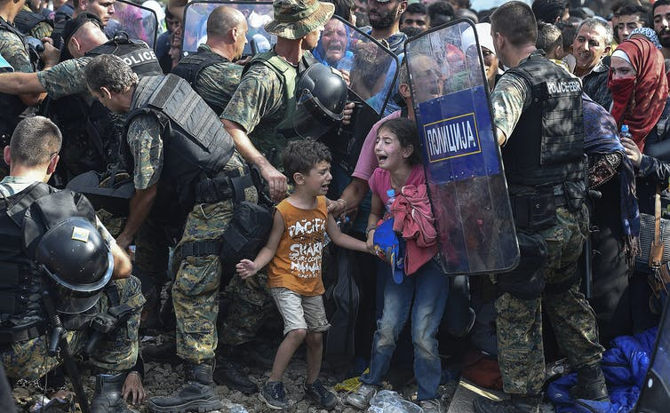 Gjorgji Lichovski Macedonian police clash with refugees at blocked border 2015