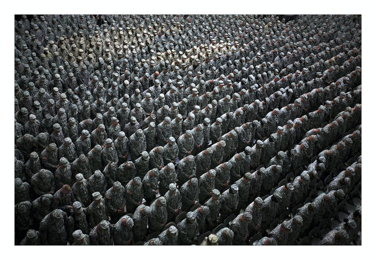 Ashley Gilbertson 1,215 American soldiers airmen marines and sailors pray before a pledge of enlistment on July 4 2008