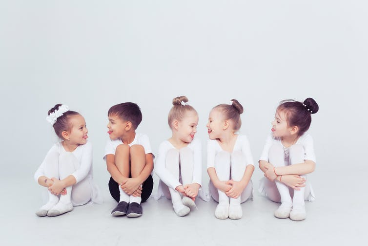 Little girls in ballet outfits with one boy