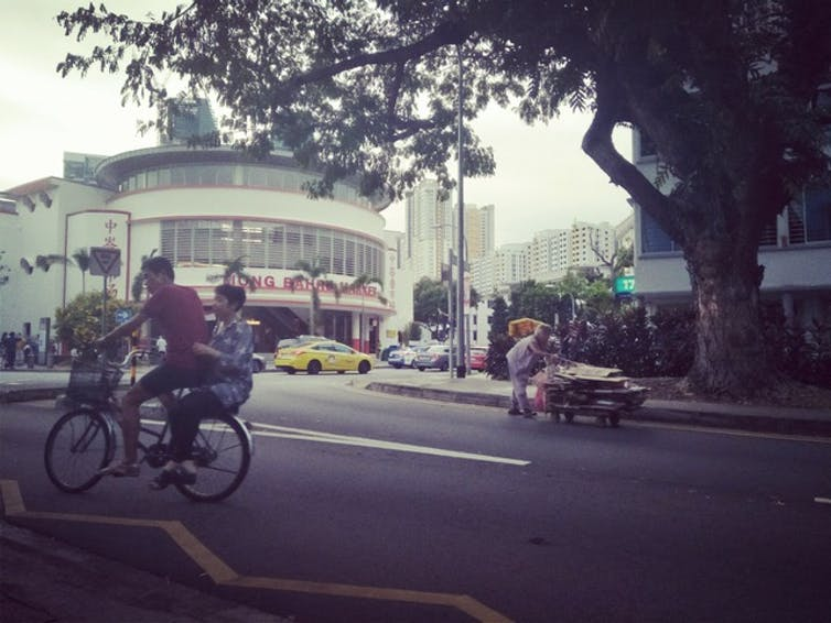 People on bike on road in Singapore